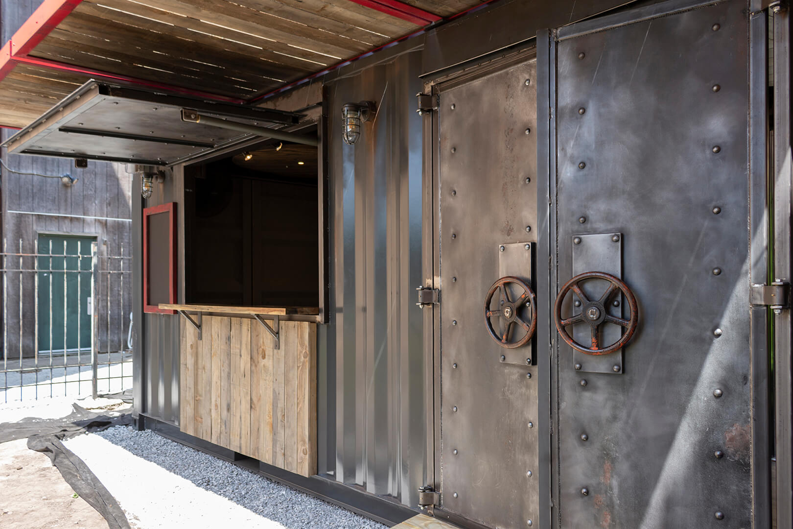 Right-angled view of the Drydock container bar, with the focus on the industrial-style doors