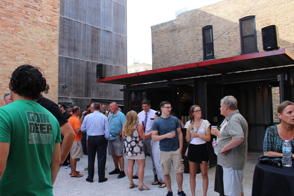 Crowd of people at the soft opening for the Drydock container bar.