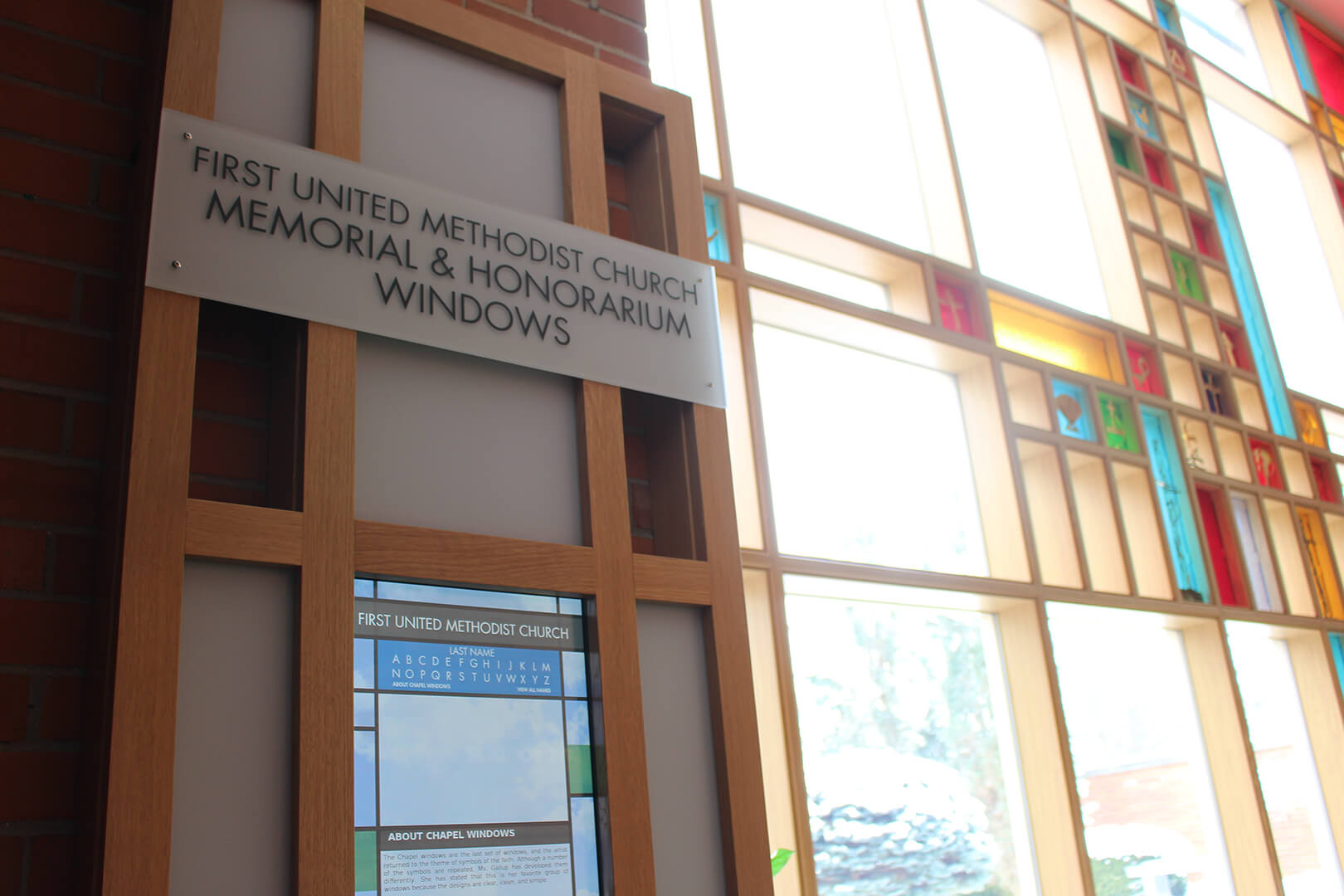 One touchscreen kiosk, with stained glass windows in the background