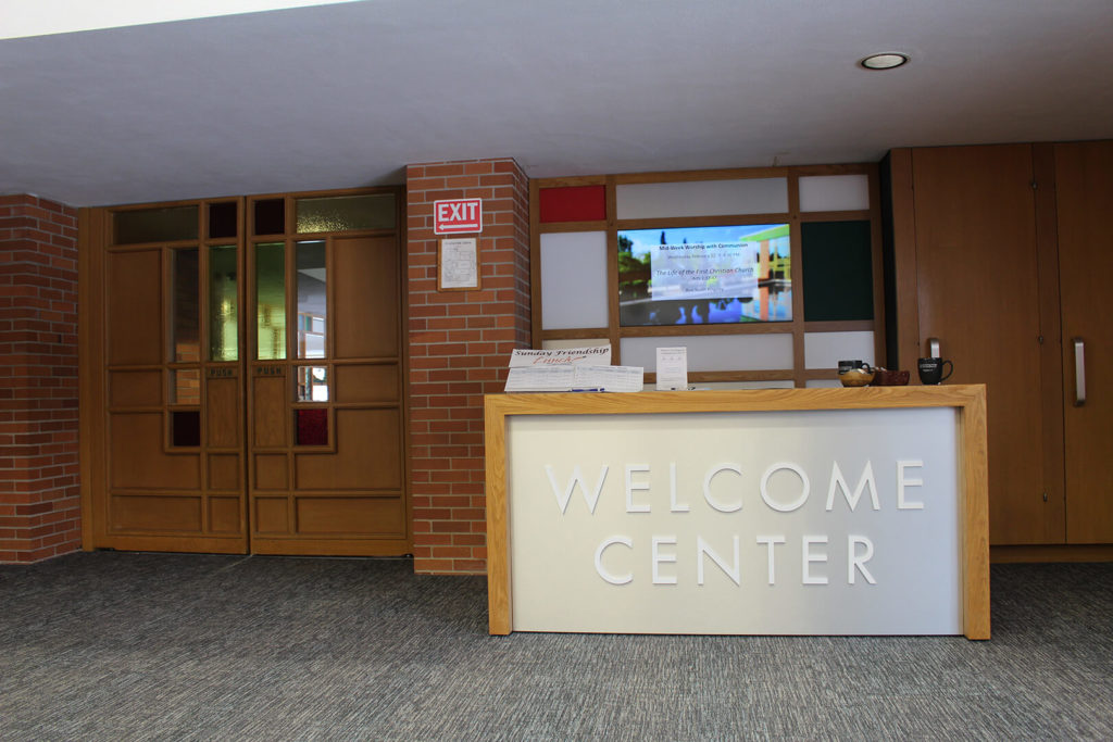 The welcome center, showing table and decorative backdrop
