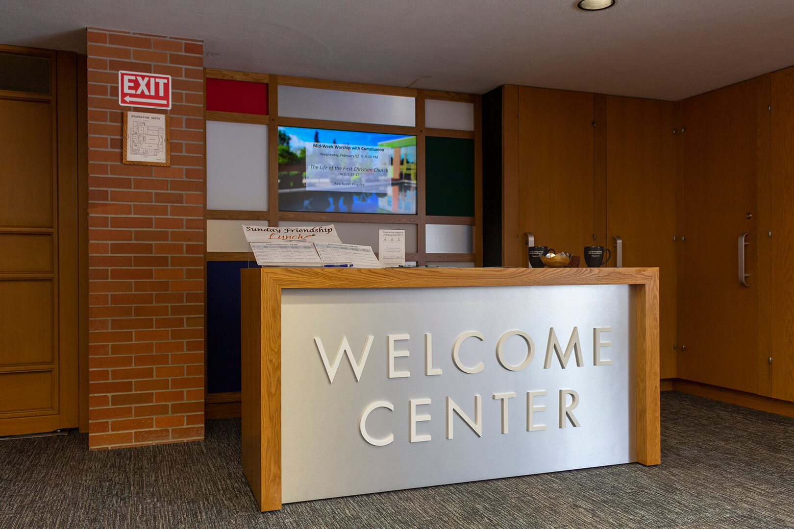 Side view of welcome center, showing table and decorative backdrop
