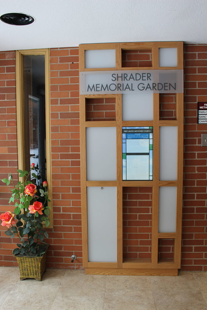 Vertical photo of touchscreen display for First United Methodist Church's memorial garden