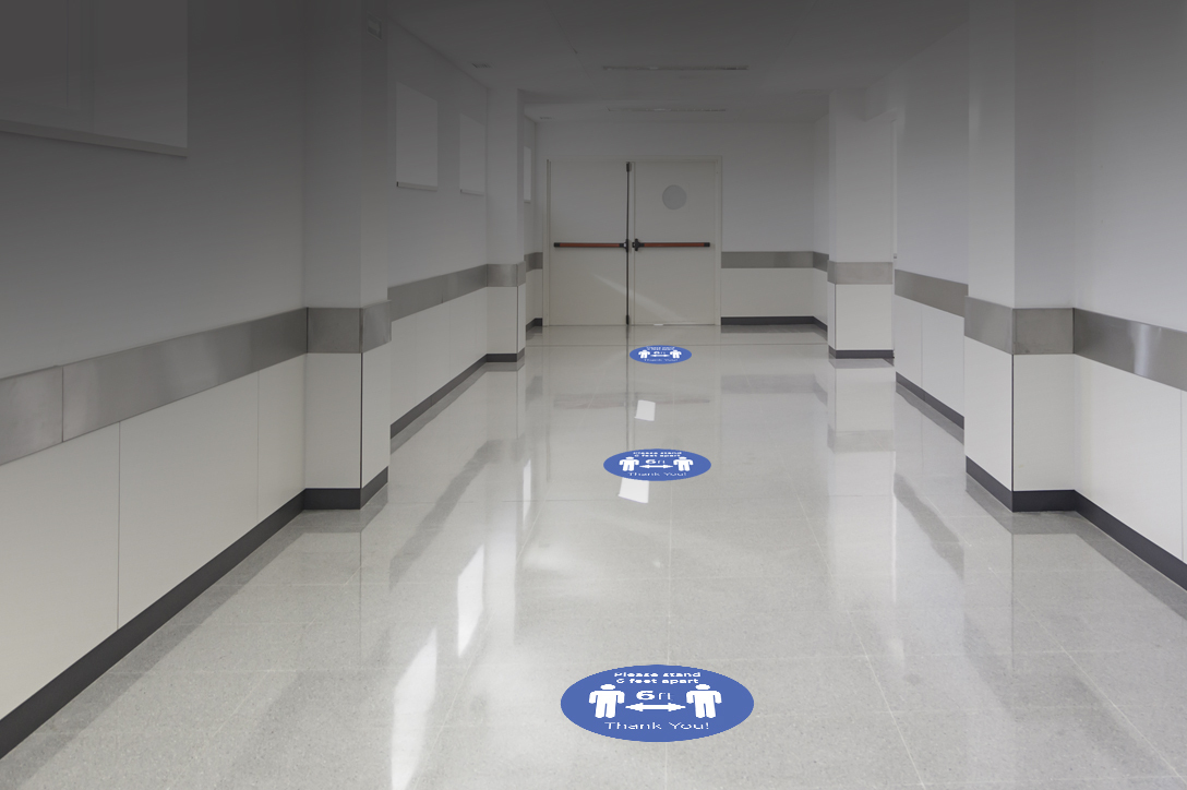 Floor decals to promote social distancing during COVID-19 pandemic