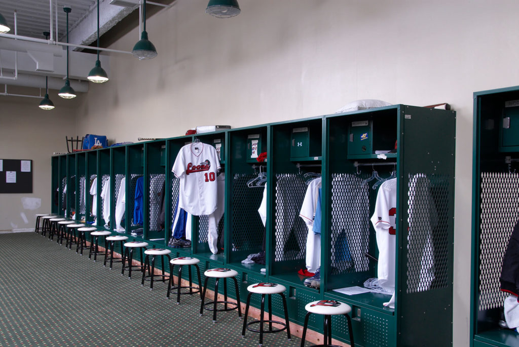 Lockers and jerseys at the Loons baseball stadium in Midland MI; room was designed by SPACE inc