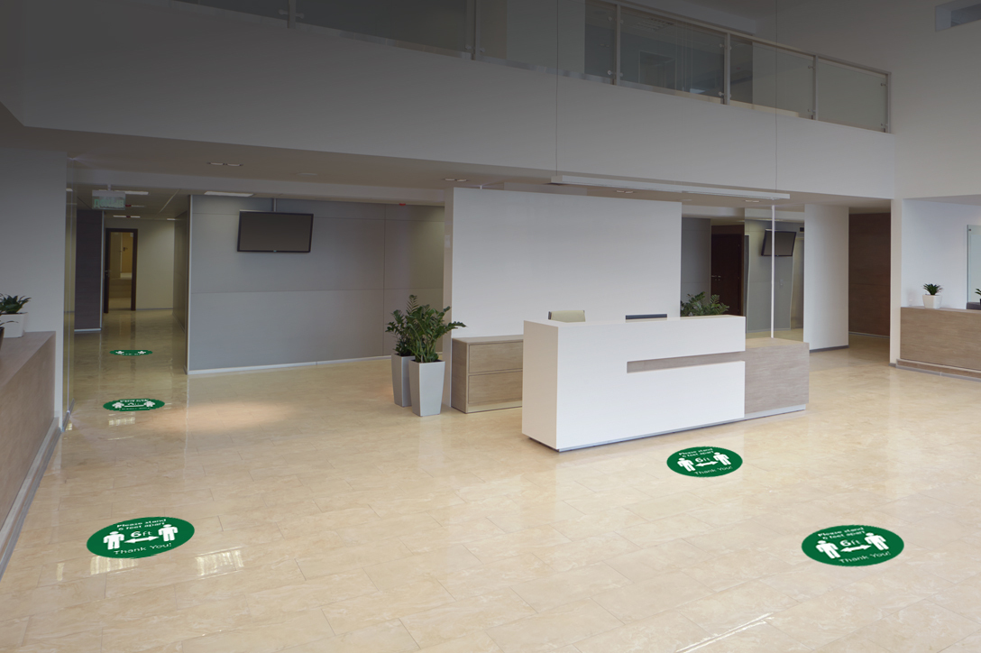 Office with floor decals to promote social distancing during COVID-19 pandemic