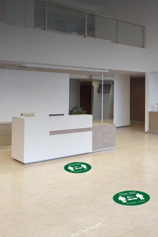 Mockup showing social distancing floor decals in office