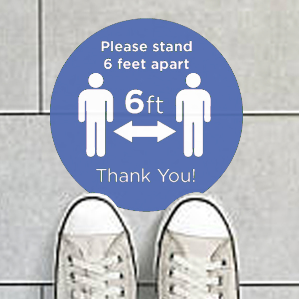 Floor decal promoting social distancing during COVID-19 pandemic