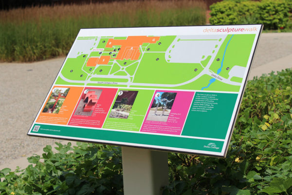 A colorful wayfinding sign ZENTX created for Delta College's Sculpture Walk