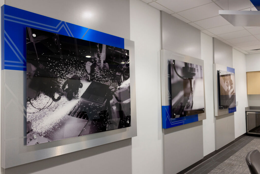 Three panels of wall art in SCE's conference room, created by ZENTX