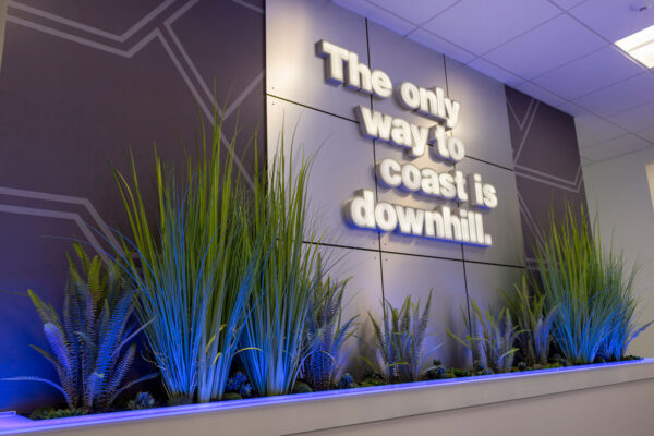 "Quote wall reading ""the only way to coast is downhill,"" created by ZENTX for Saginaw Control and Engineering's offices"