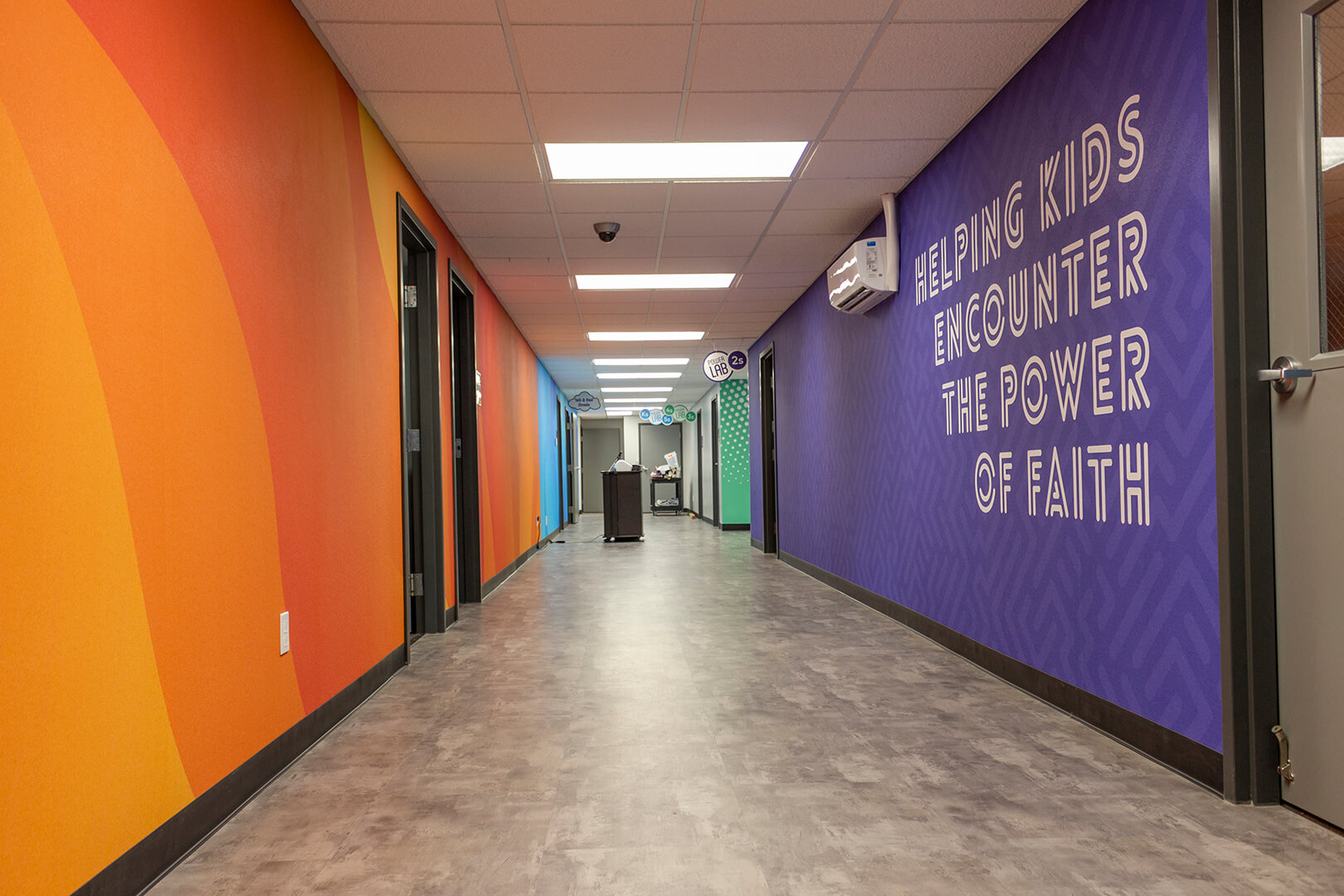 Hallway at Christian Celebration Center, showing orange, blue, and purple wallpapers