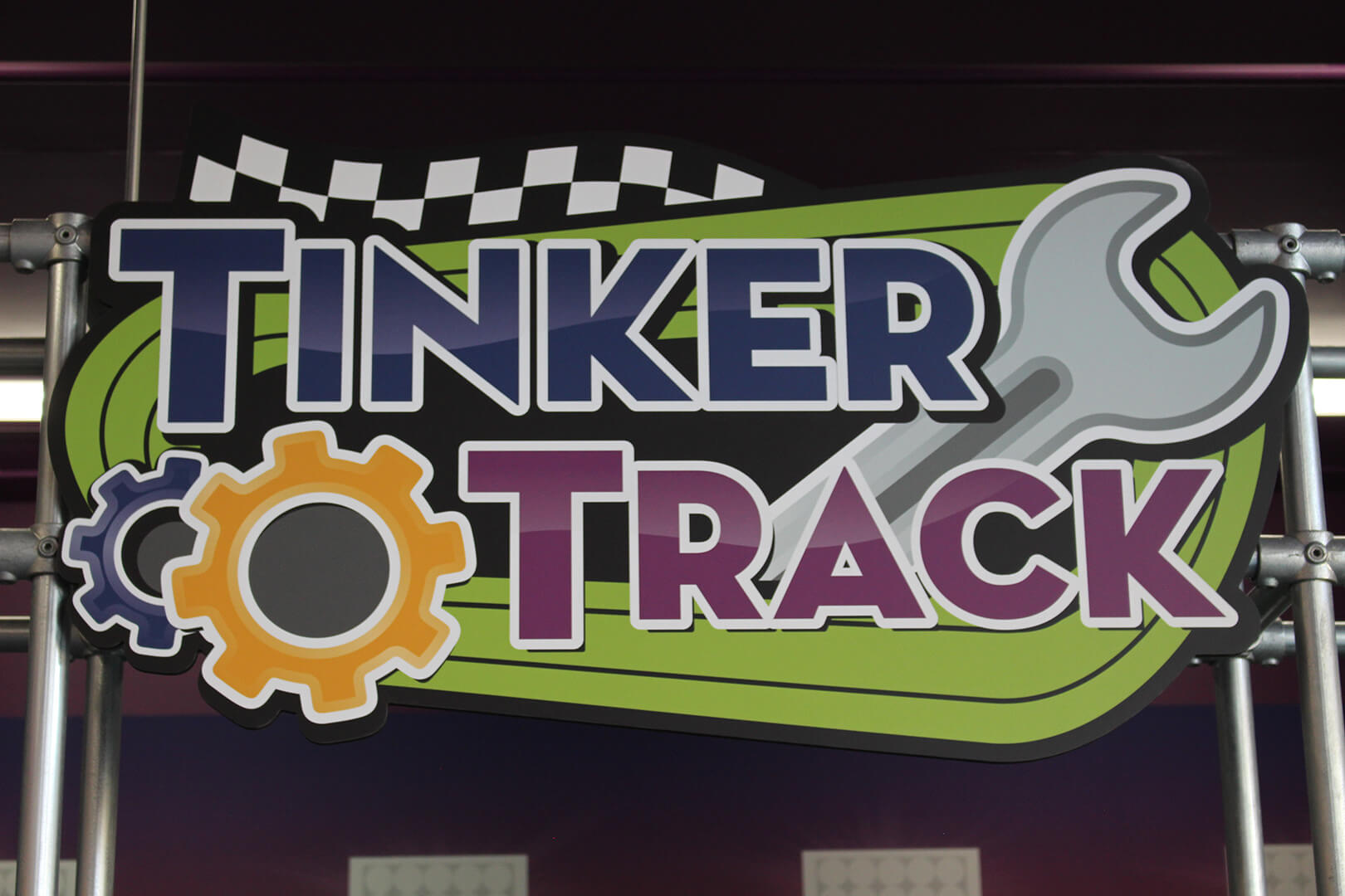 "Sign reading ""Tinker Track"" for exhibit at Mid-Michigan Children's Museum"