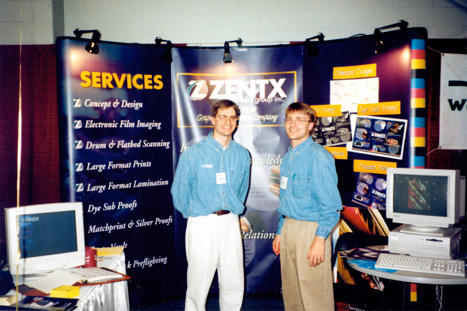 Mark and Mike Wenz standing in front of ZENTX's trade show booth