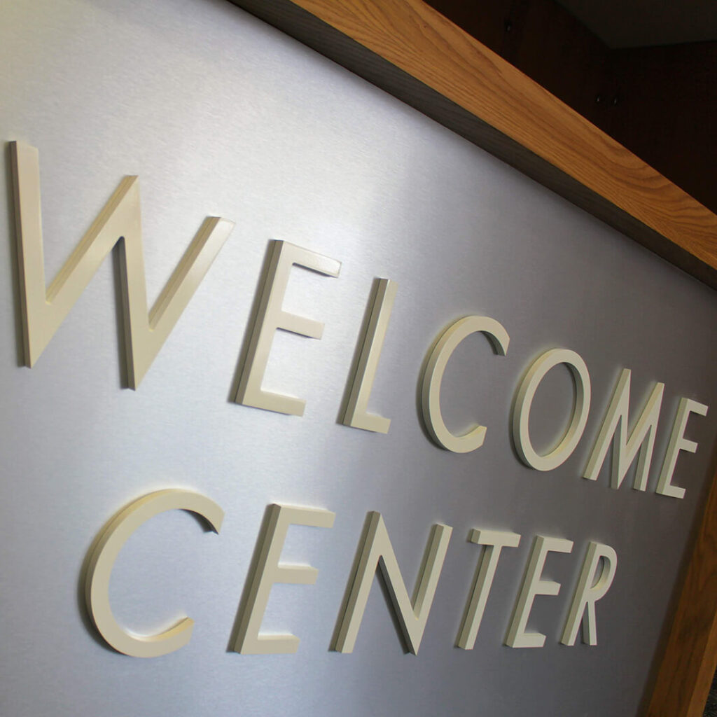 """Closeup of dimensional letters reading """"Welcome Center"""""""