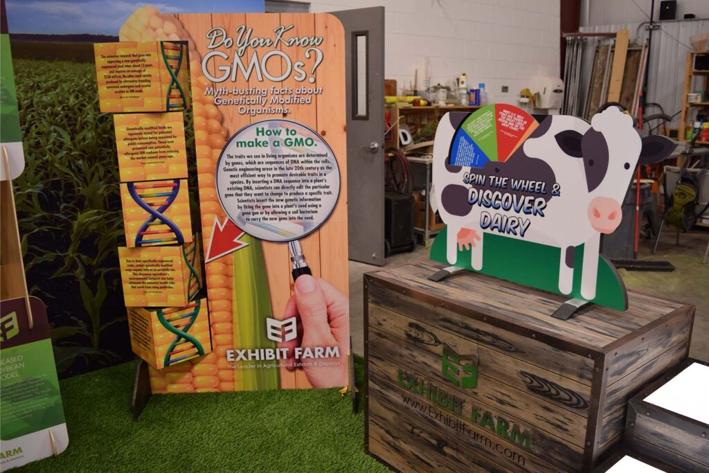 A display about GMOs and a cow-shaped display about dairy, developed by Exhibit Farm
