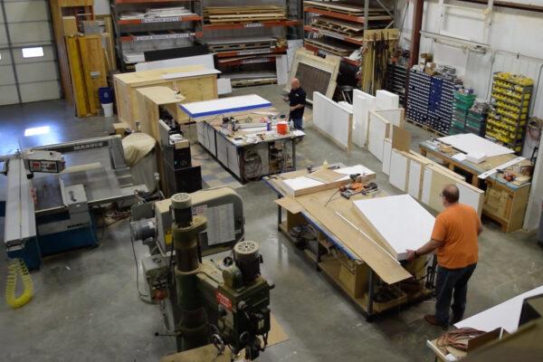 Craftsmen working in the ZENTX workshop