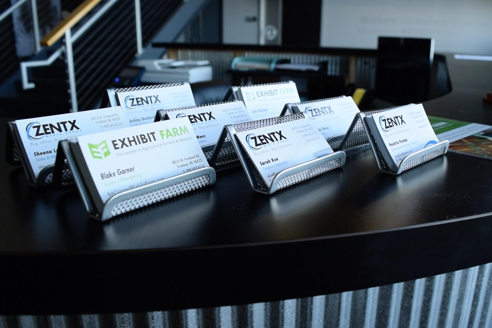 Business cards on ZENTX's front desk